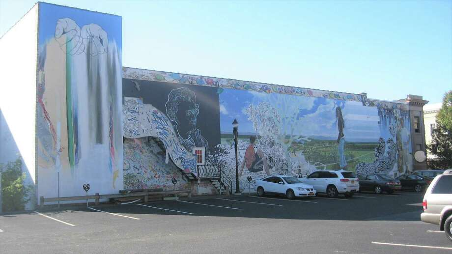 Work is ongoing to preserve this mural and move it. The mural was created in 2011 on the Libby building, home of the former Libby's Furniture store. Photo: John Torsiello /