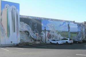 Work is ongoing to preserve this mural and move it. The mural was created in 2011 on the Libby building, home of the former Libby's Furniture store.