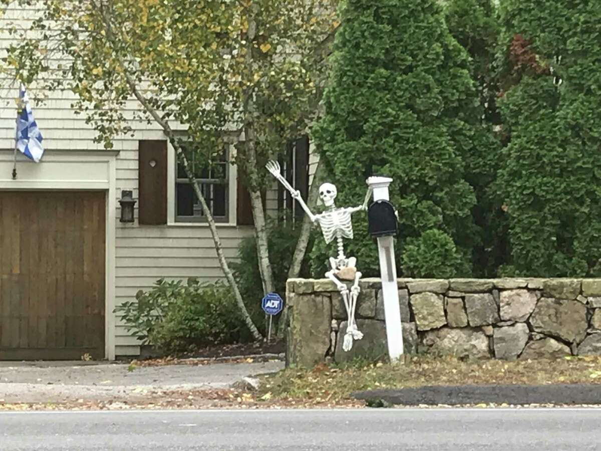 A Halloween 'spirit' greets drivers on the Post Road in Darien.