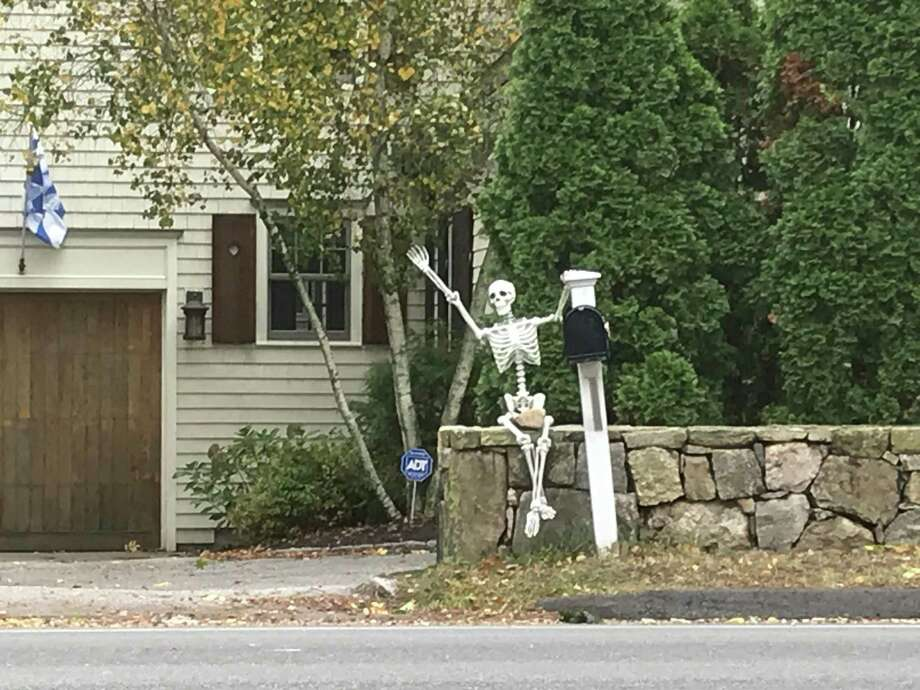 A Halloween 'spirit' greets drivers on the Post Road in Darien. Photo: Susan Shultz /Hearst Connecticut Media /