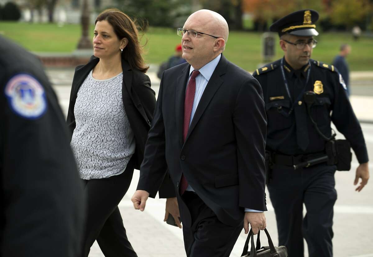 Philip Reeker, center, acting assistant secretary of state for Europe, arrives to the Capitol for closed door interview at the Capitol in Washington, Saturday, Oct. 26, 2019. Like other impeachment inquiry witnesses, the Trump administration has directed Reeker not to testify, according to a person familiar with the situation who insisted on anonymity to discuss the interaction. But Reeker appeared anyway after receiving his subpoena from the House, the person said. (AP Photo/Jose Luis Magana)