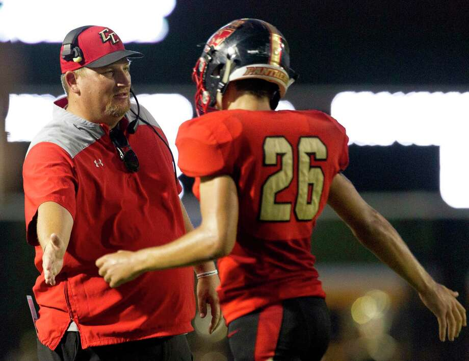 Caney Creek head coach Ned Barrier gives running back Camden Pyle (26) a high-five after scoring his second touchdown of the first half during a non-district high school football game at Woodforest Bank Stadium, Thursday, Sept. 5, 2019, in Shenandoah. Photo: Jason Fochtman, Houston Chronicle / Staff Photographer / Houston Chronicle