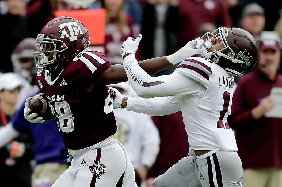 Texas A&M running back Isaiah Spiller (28) stiff arms Mississippi State safety Jaquarius Landrews (11) to avoid a tackle during the first quarter of an NCAA college football game, Saturday, Oct. 26, 2019, in College Station, Texas. (AP Photo/Sam Craft) Photo: Sam Craft, Associated Press / Copyright 2019 The Associated Press. All rights reserved.