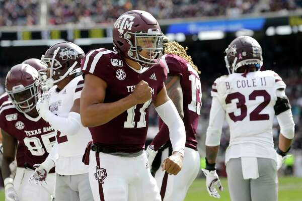 Texas A&M quarterback Kellen Mond (11) reacts after scoring a touchdown against Mississippi State during the first quarter of an NCAA college football game, Saturday, Oct. 26, 2019, in College Station, Texas. (AP Photo/Sam Craft)