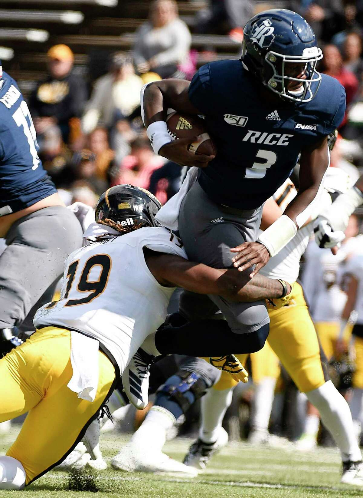 Rice quarterback JoVoni Johnson (3) is tackled by Southern Miss defensive back Ky'el Hemby during the first half of an NCAA college football game, Saturday, Oct. 26, 2019, in Houston.