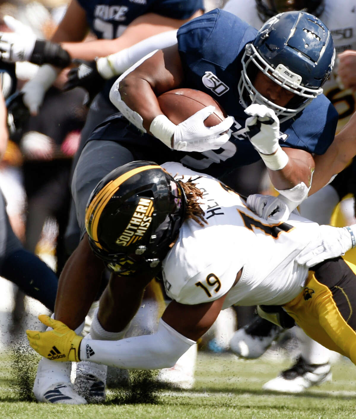 Rice running back Nahshon Ellerbe, top, is tackled by Southern Miss defensive back Ky'el Hemby during the first half of an NCAA college football game, Saturday, Oct. 26, 2019, in Houston.