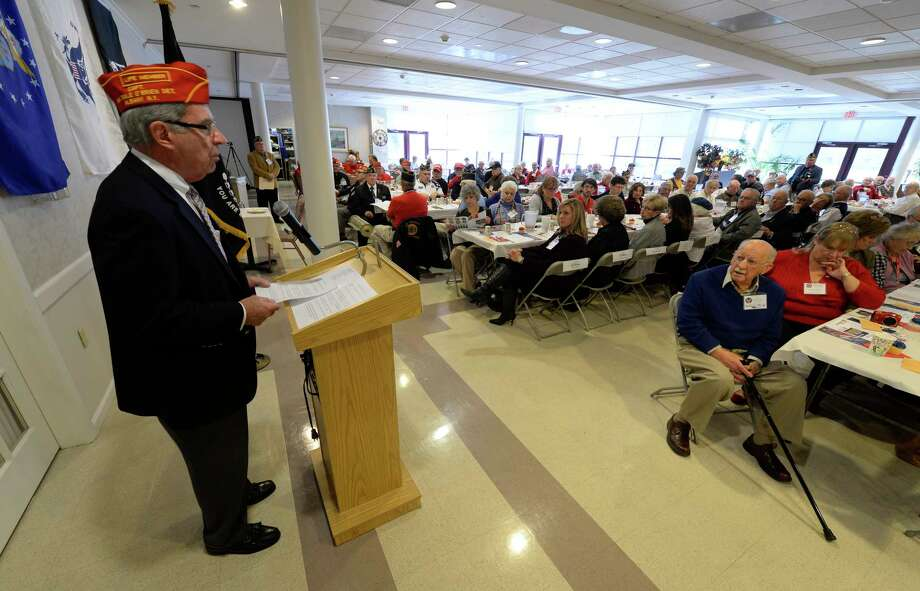 Former Marine, Mike Hoblock gives an explanation of the derivation of Veteran's Day at the Colonie Senior Service Center's annual Veterans Luncheon Nov. 4, 2013,  sponsored by First Niagara in Colonie, N.Y.  Veterans Day is celebrated on the 11th hour of the 1th day of the 11th month of the year annually.  (Skip Dickstein/Times Union Photo: SKIP DICKSTEIN / 00024500A