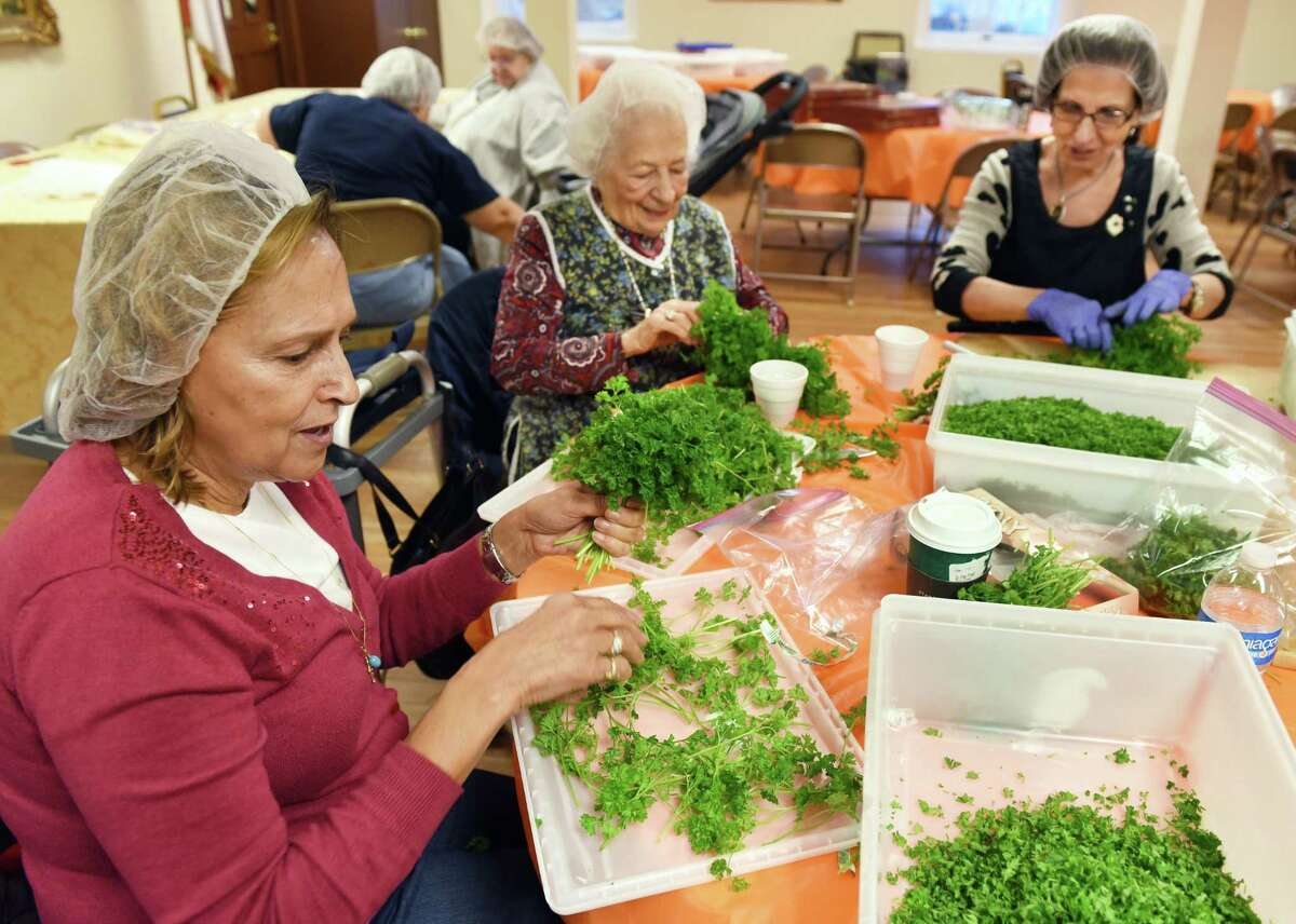 From left: Denise Nahal of East Greenbush, Evelyn Hakim of Watervliet and Georgette Hannoush of Loudonville chop parsley for Tabouli as St. Ann's Maronite Catholic community prepares foods for the Hafli, an annual party in Lebanese tradition dating back centuries, on Thursday Nov. 3, 2016, at St. Ann Maronite Catholic Chur in Watervliet, N.Y. (John Carl D'Annibale / Times Union)