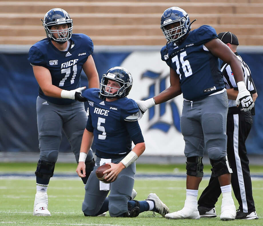 Rice quarterback Wiley Green (5) is helped to his feet after being sacked by offensive lineman Clay Servin (71) and offensive lineman Justin Gooseberry during the first half of an NCAA college football game against Southern Miss, Saturday, Oct. 26, 2019, in Houston. Photo: Eric Christian Smith, Contributor / Houston Chronicle