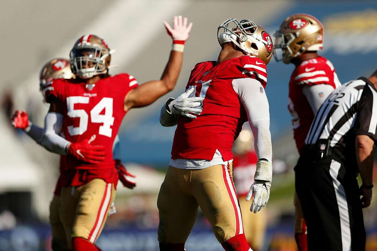 San Francisco 49ers' Arik Armstead and Fred Warner celebrate a sack of Los Angeles Rams' Jared Goff during Niners' 20-7 win in NFL game at Los Angeles Coliseum in Los Angeles, Calif., on Sunday, October 13, 2019.