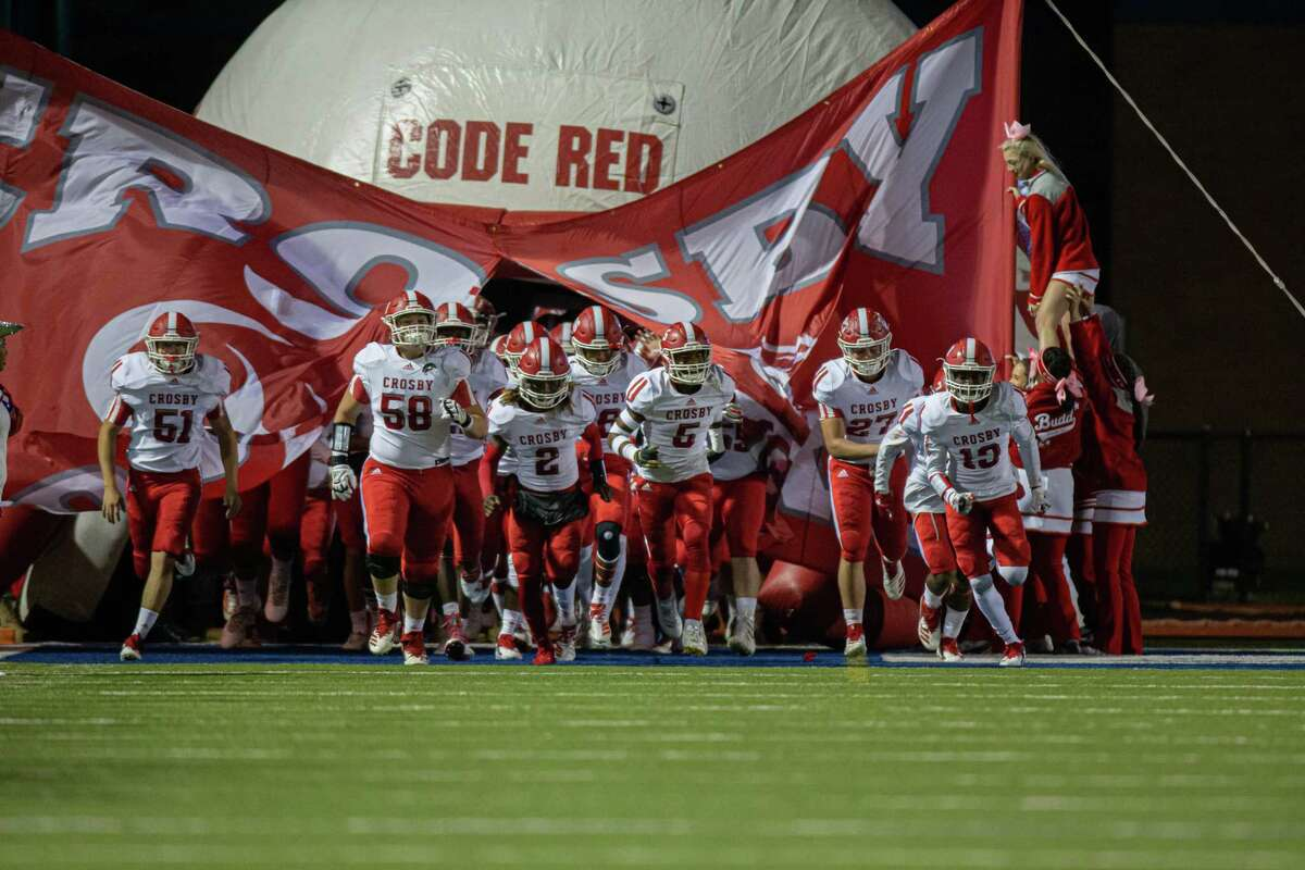Crosby Cougars enter the field during the first half of action between the Barbers Hill Eagles and the Crosby Cougars during an UIL 5A high school football game at the Barbers Hill Eagle Stadium, Friday, October 25, 2019, in Rosenberg. Barbers Hill Eagle defeated Crosby Cougars 28-7 (Juan DeLeon/Contributor)
