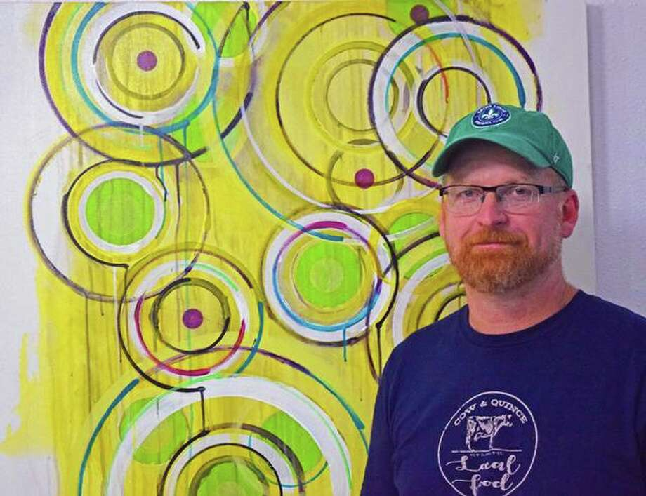 Michael Kathriner stands next to one of his paintings on display at Sherry's Snacks in Edwardsville. Photo: Tyler Pletsch | The Intelligencer