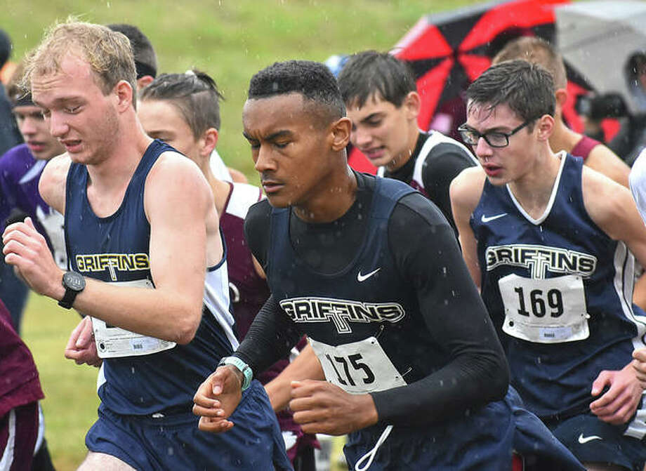 Father McGivney's Zach Brasel, left, Tyler Guthrie, center, and Brandon Ahring get off to a quick start in the Class 1A New Athens Regional inside Okaw Valley Park on Saturday in New Athens. Photo: Matt Kamp|The Intelligencer
