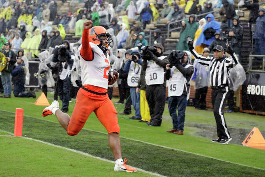 Illinois running back Reggie Corbin (2) reacts after running for a touchdown Saturday tagainst Purdue in West Lafayette, Ind. Photo: AP Photo