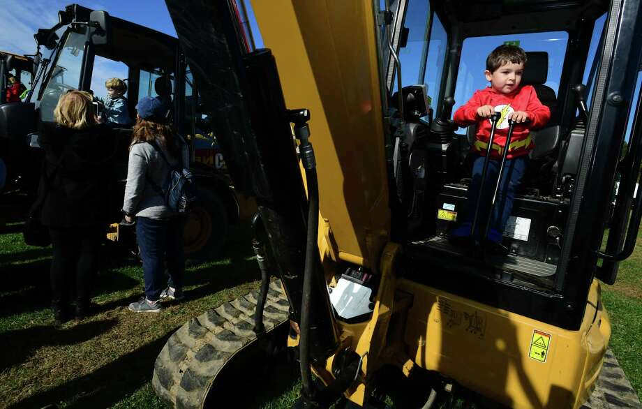 Norwalk resident Wyatt Eichholtz, 3, sits in an excavator during The 8th Annual KIDZFEST Touch a Truck & More Saturday October 26, 2019, at Taylor Farm Park in Norwalk, Conn. The family event that benefitted the Children's Connection offered a unique opportunity for young and old to get in and explore construction equipment of all sizes, emergency vehicles and recreation vehicles that are typically off limits to the public. KIDZFEST is the biggest touch-a-truck event in the state and featured excavators, back hoes, skid steers, wheel loaders, dump trucks, police and fire vehicles, boats, race cars, garbage trucks, and semi-tow trucks . The event also offered face painting, mascots, rides on the Roaming Railroad, dancing, music, food and games. Children's Connection Child Advocacy Center's work to support children who have been sexually and physically abused in Fairfield County. Photo: Erik Trautmann / Hearst Connecticut Media / Norwalk Hour