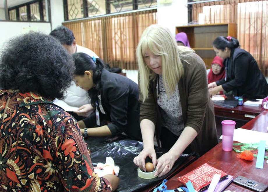 SIUE STEM Center Executive Director Sharon Locke helps introduce STEM education techniques in an Indonesian classroom.