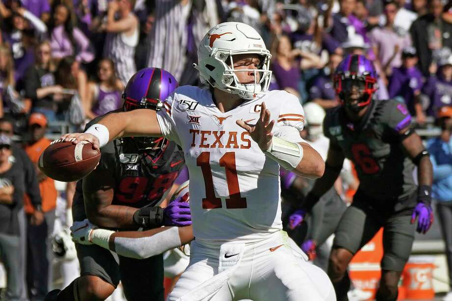 Texas quarterback Sam Ehlinger (11) throws a pass in the first half of an NCAA college football game against TCU in Fort Worth, Texas, Saturday, Oct. 26, 2019. (AP Photo/Louis DeLuca) Photo: Louis DeLuca, Associated Press / FR171672 AP