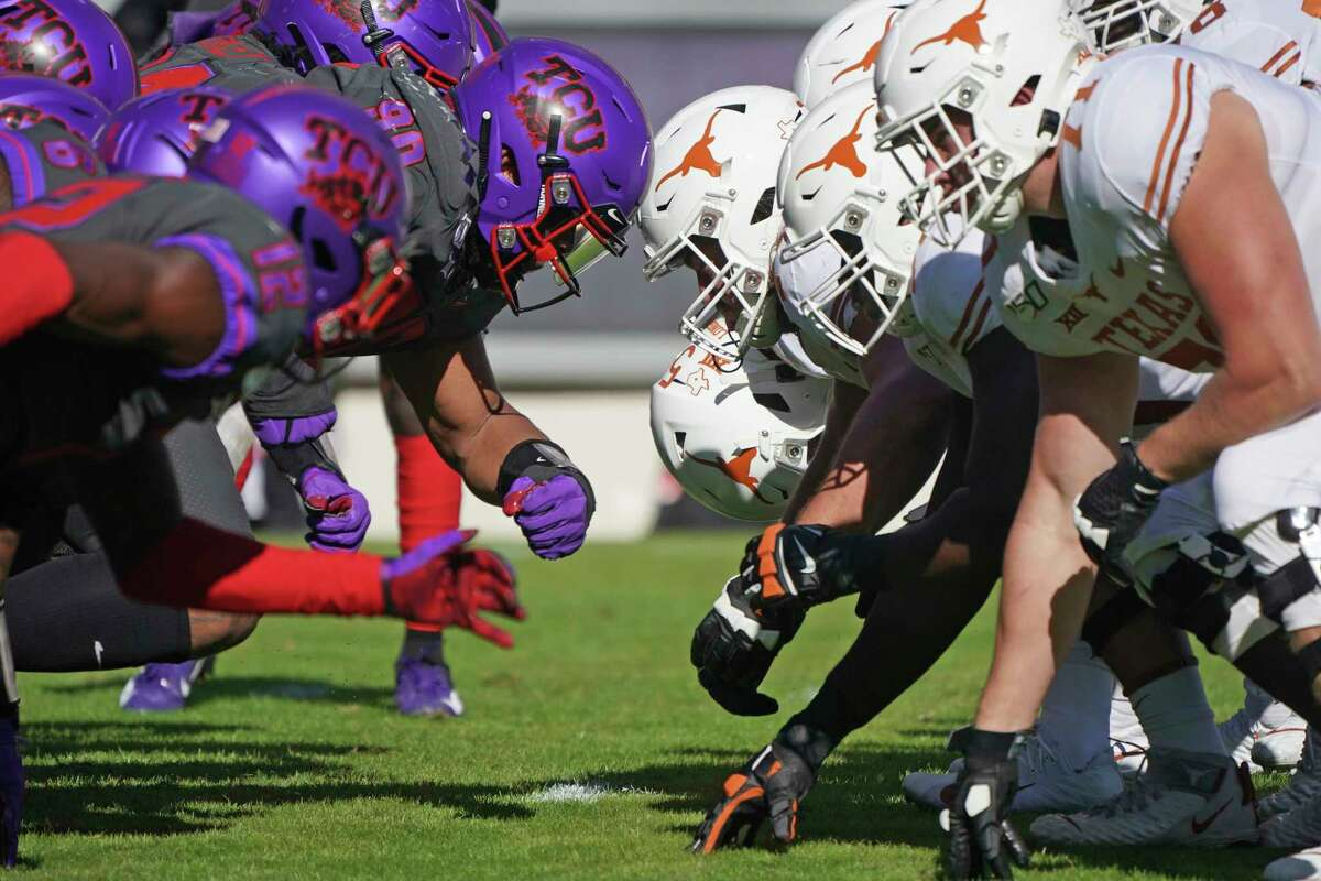 TCU and Texas linemen square off at the line of scrimmage on an extra point try in the first half of an NCAA college football game in Fort Worth, Texas, Saturday, Oct. 26, 2019. (AP Photo/Louis DeLuca)
