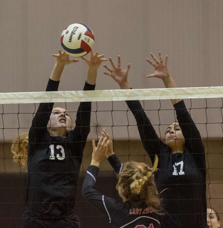 Midland Classical's Marin Casey (13) and Jenny Coco (17) blocks Central Texas Christian's Amy Lucas hit on Saturday, Oct. 26, 2019 at Midland Classical Academy. Photo: Jacy Lewis/Reporter-Telegram
