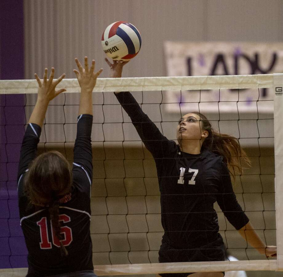 Midland Classical's Jenny Coco (17) tips the ball over Central Texas Christian's Anna Grace Mixon (16) block on Saturday, Oct. 26, 2019 at Midland Classical Academy. Photo: Jacy Lewis/Reporter-Telegram
