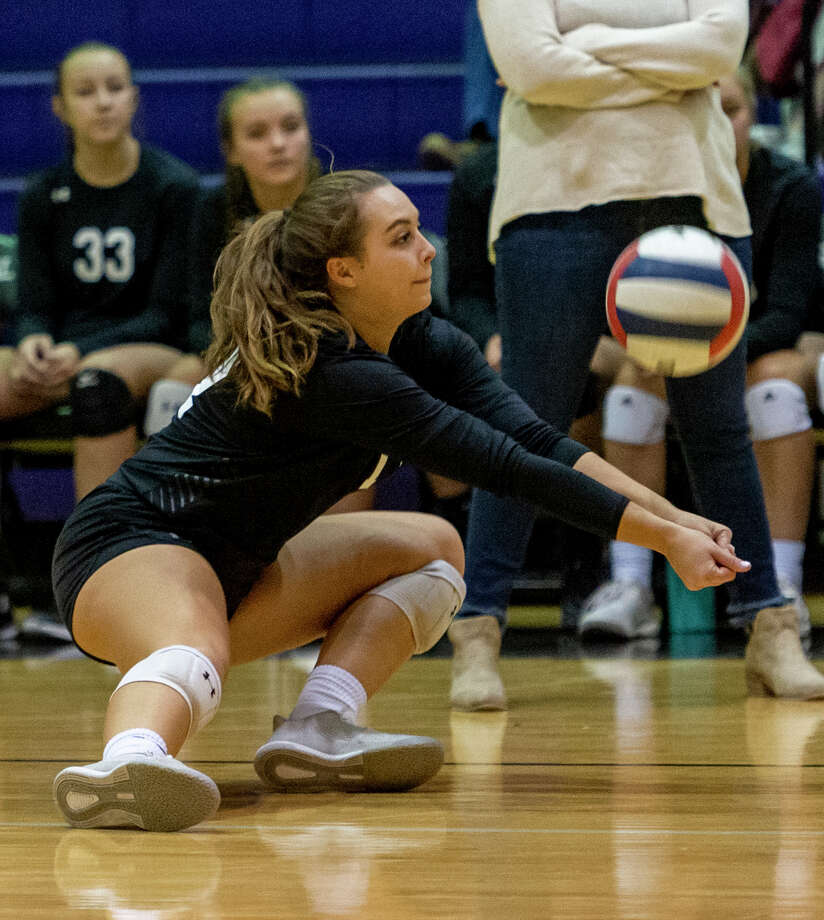 Midland Classical's Jenny Coco digs the ball Saturday, Oct. 26, 2019 at Midland Classical Academy. Photo: Jacy Lewis/Reporter-Telegram