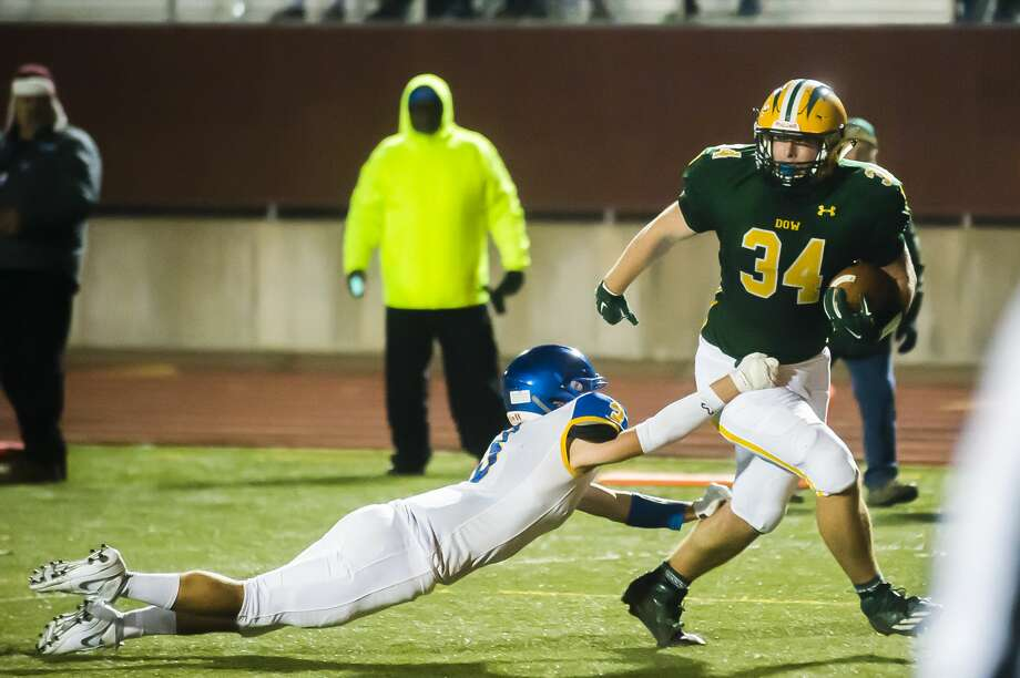 Dow High's Evan Metiva breaks a tackle during Friday's 42-7 win over Midland High. Photo: Katykildee/kildee@mdn.net