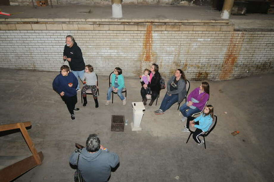 "Youthful ghost hunters and their parents prepare for ""lights out"" in the basement pool area of the Mineral Springs Hotel, an area that produced reports of several personal paranormal experiences on Saturday. Photo: David Blanchette 