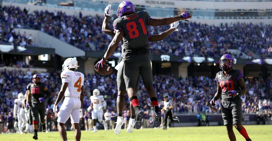 FORT WORTH, TEXAS - OCTOBER 26:  Pro Wells #81 of the TCU Horned Frogs celebrates a touchdown with Taye Barber #4 against the Texas Longhorns in the first half at Amon G. Carter Stadium on October 26, 2019 in Fort Worth, Texas. (Photo by Ronald Martinez/Getty Images) Photo: Ronald Martinez/Getty Images