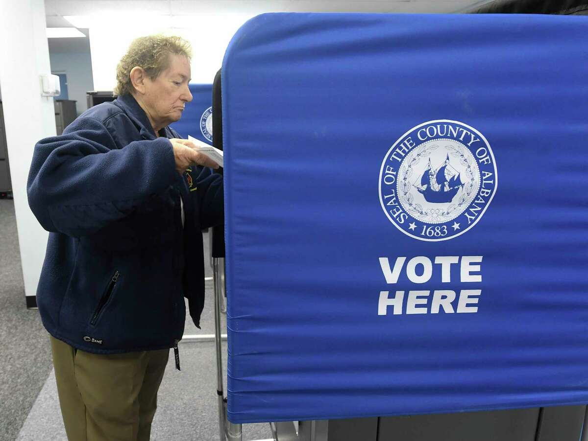 Doris Hallenbeck of Colonie, N.Y., takes advantage of a new early voting election law to cast her vote before the Tuesday November 5th. general election at the Albany County Board of Elections Saturday, Oct. 26, 2019, in Albany, N.Y. (Hans Pennink / Special to the Times Union)