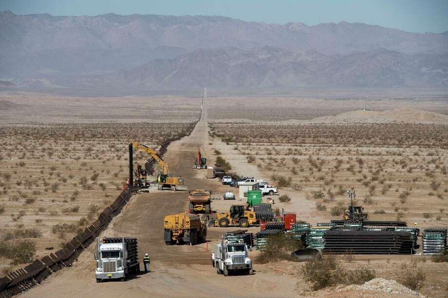 Construction begins on Aug. 23 along the U.S.-Mexico border, where the Trump administration has promised to complete nearly 500 miles of new fencing by the end of 2020. Photo: Washington Post Photo By Carolyn Van Houten / The Washington Post
