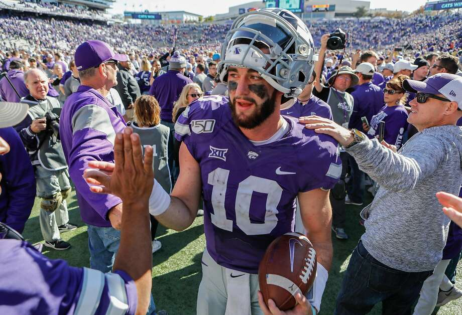 Kansas State quarterback Skyler Thompson celebrates. Photo: Travis Heying / Wichita Eagle