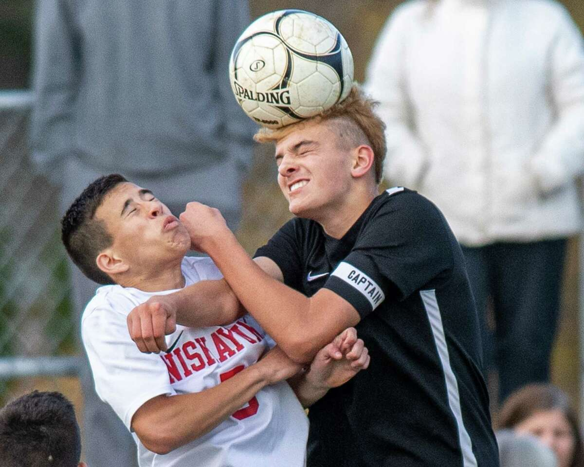 Bethlehem defender Lleyton Emery gets a head on the ball in front of Niskayuna midfielder Matt Styles during a Section II Class AA quarterfinal game at Bethlehem High School on Saturday, Oct. 26, 2019 (Jim Franco/Special to the Times Union.)