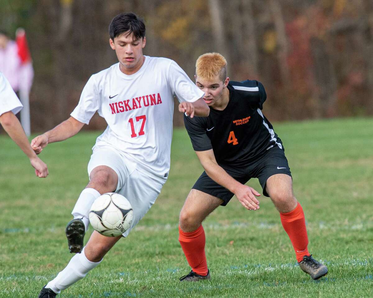 Niskayuna midfielder Nicholas Lomonoco gets position in front of Bethlehem defender Jack Burman during a Section II Class AA quarterfinal game at Bethlehem High School on Saturday, Oct. 26, 2019 (Jim Franco/Special to the Times Union.)