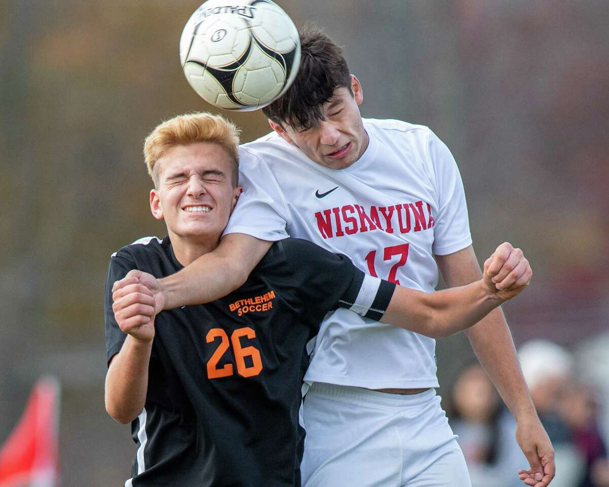 Bethlehem defender Lleyton Emery and Niskayuna midfielder Nicholas Lomonoco battle for position during a Section II Class AA quarterfinal game at Bethlehem High School on Saturday, Oct. 26, 2019 (Jim Franco/Special to the Times Union.)