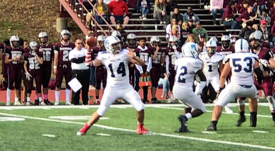 Middletown quarterback Chris Danas threw for 515 yards, 5 TDs to lead Middletown over Farmington. Photo: Paul Augeri / For Hearst Connecticut Media