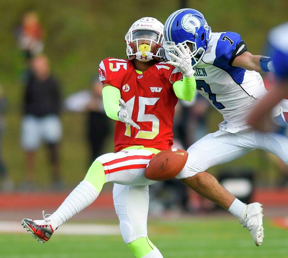 Greenwich's AJ Barber (15) has a pass broken up by Darien's Connor O'Malley in the first half of last week's game in Greenwich. Darien won 27-21. Photo: Matthew Brown / Hearst Connecticut Media / Stamford Advocate