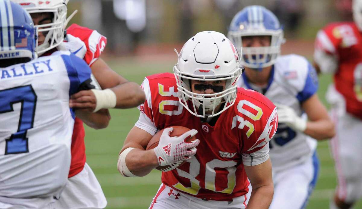 Greenwich's Hunter Clark runs against Darien at Cardinal Stadium in Greenwich.