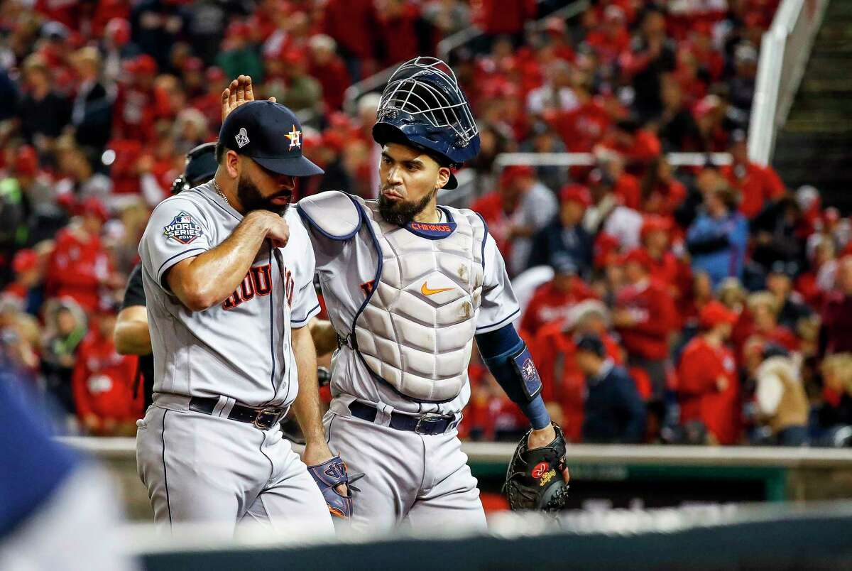 Houston Astros catcher Robinson Chirinos (28) pats Houston Astros starting pitcher Jose Urquidy (65) on the head as they walk back to the dugout at the end of the third inning of Game 4 of the World Series at Nationals Park in Washington, D.C. on Saturday, Oct. 26, 2019.