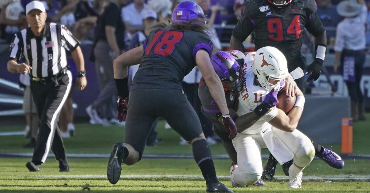 Texas quarterback Sam Ehlinger (11) is tackled by TCU safety Innis Gaines (6) in the second half of an NCAA college football game in Fort Worth, Texas, Saturday, Oct. 26, 2019. (AP Photo/Louis DeLuca)