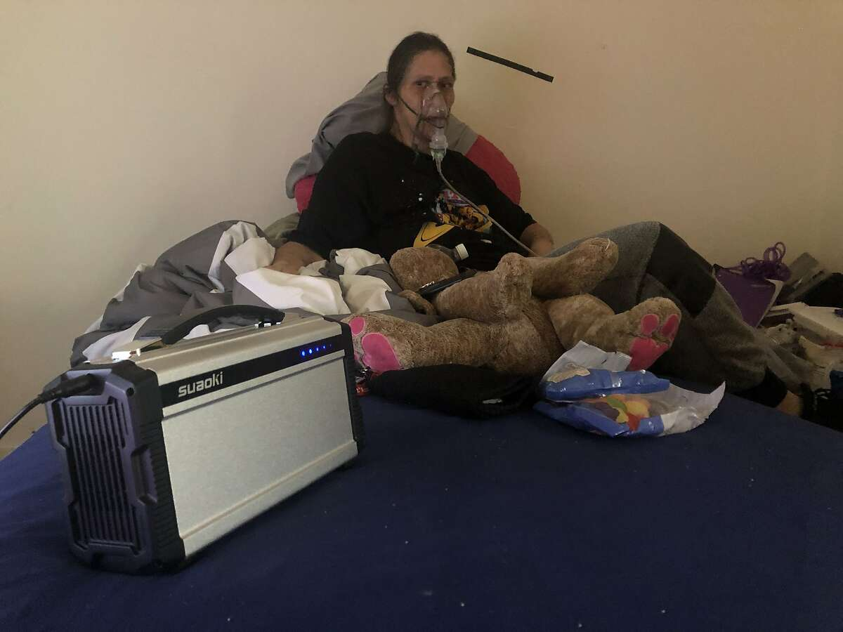 Toni Vazquez will power the nebulizer she uses every morning, sometimes more, for asthma and other breathing conditions, with this back up battery charger during the outage. She lives in St. Vincent's Bridge to Housing shelter in San Rafael, photographed inside her room on Oct. 26, 2019.
