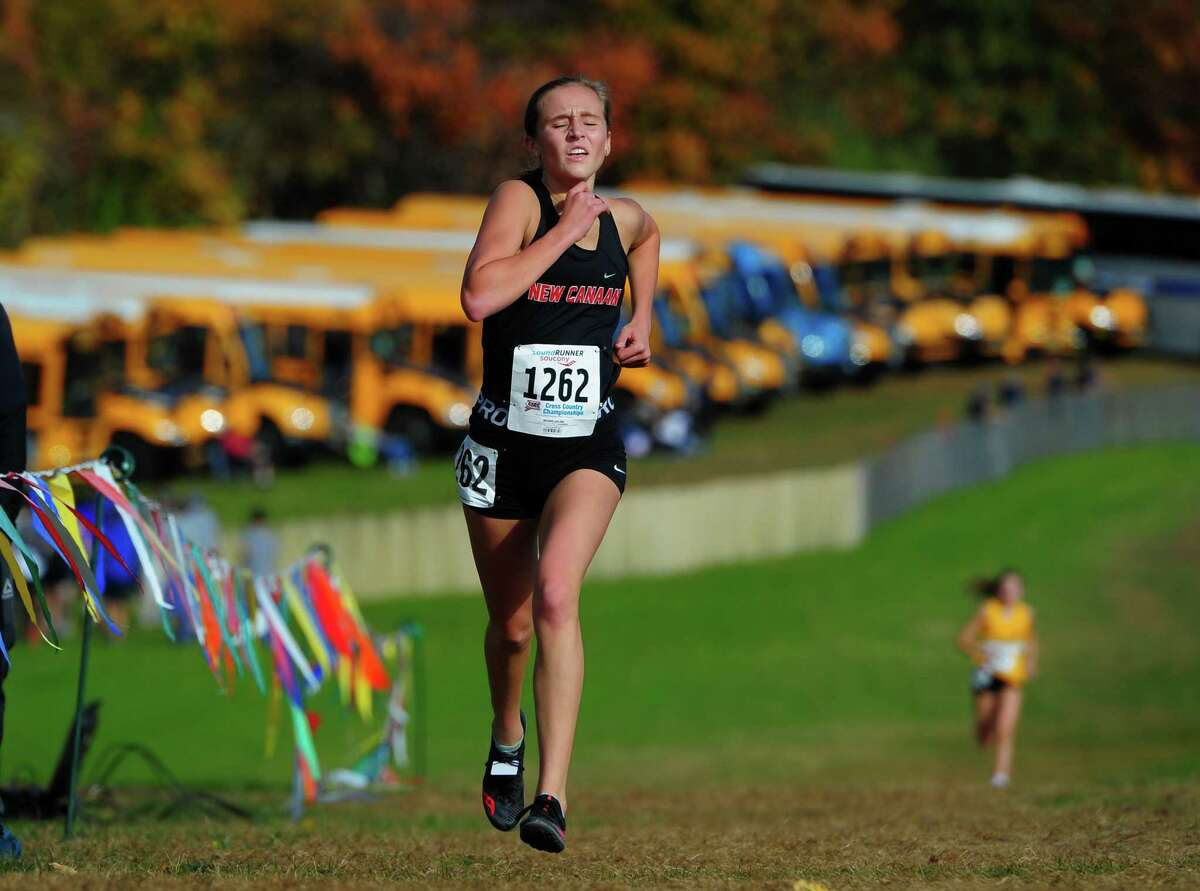 New Canaan's Molly Murphy arrives at the finish line during Class L cross country championship action in Manchester, Conn., on Saturday Oct. 26, 2019.
