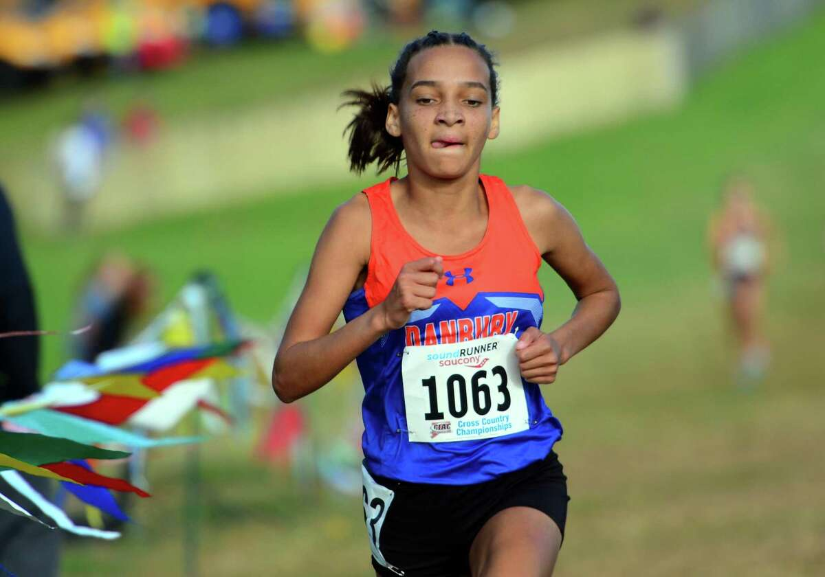 Danbury's Daniella Grullon Pena crosses the finish line for third place during Class L cross country championship action in Manchester, Conn., on Saturday Oct. 26, 2019.