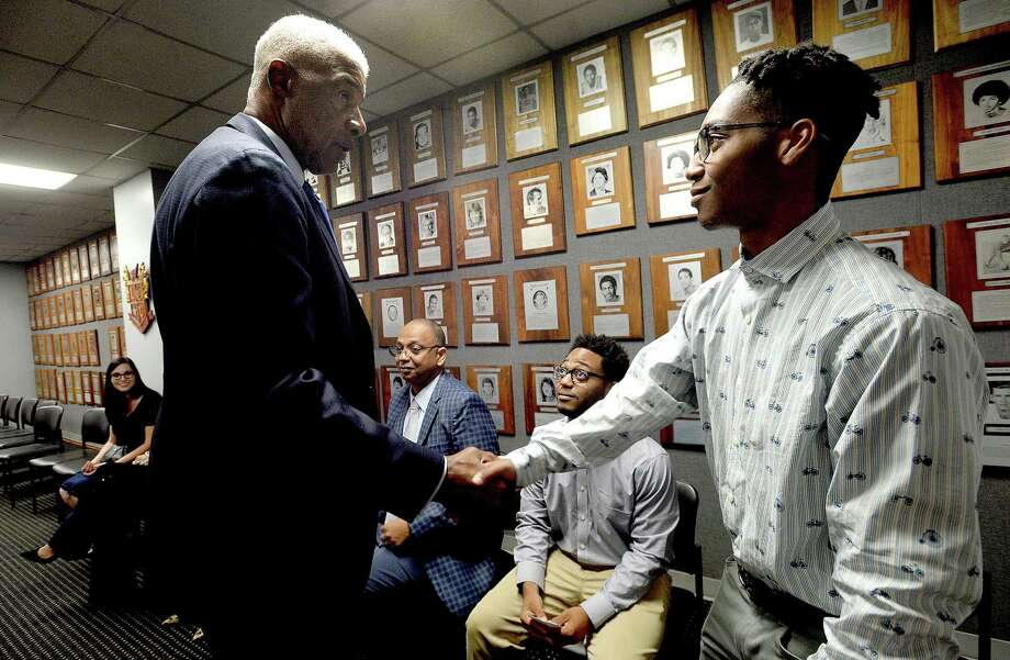 NBA legend Julius Erving, aka Dr. J, greets Lamar junior Bryce Clark (left) and his brother Braiden Clark, a junior and basketball player at Hardin-Jefferson, during a VIP meet and greet before Lamar's Tip Off Banquet at the Montagne Center Saturday.  Photo taken Saturday, October 26, 2019 Kim Brent/The Enterprise Photo: Kim Brent / The Enterprise / BEN