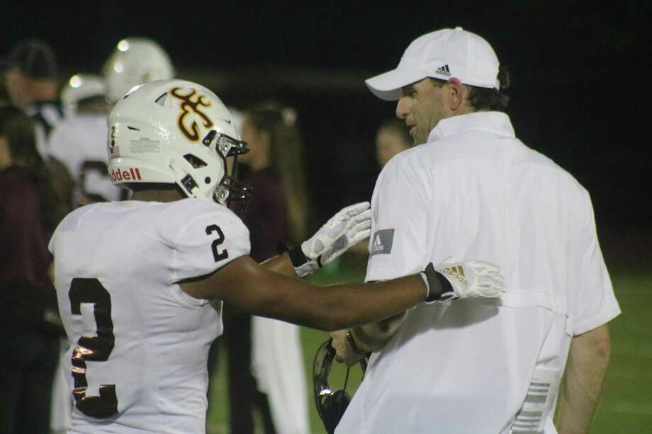 Deer head coach Austin Flynn watched co-captain Marcus Molina (2) score two touchdowns, one on offense, one on special teams in the team's 49-14 victory over Sterling Friday night. Photo: Robert Avery