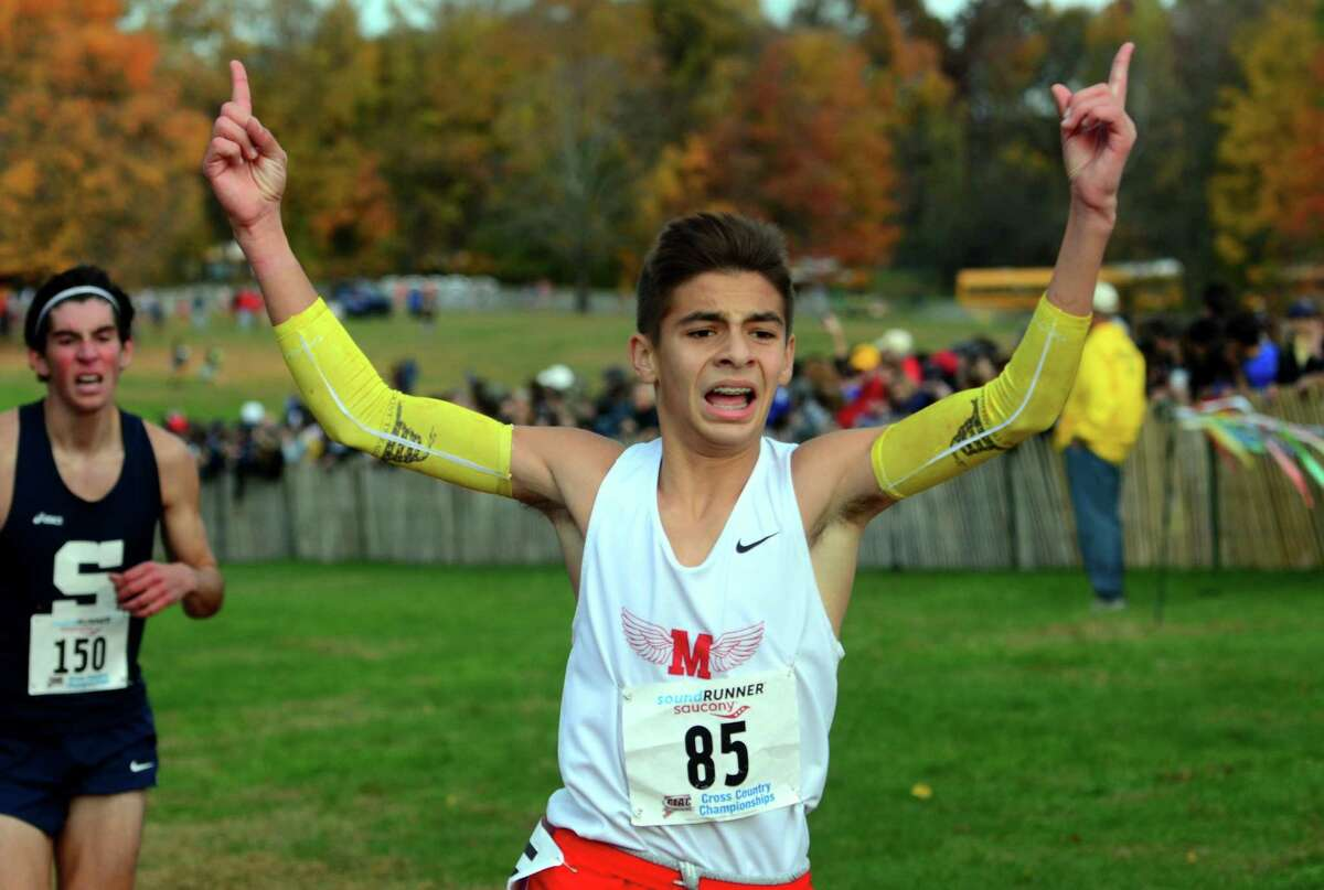 Manchester's Sean Barkasy crosses the finish line during Class LL cross country championship action in Manchester, Conn., on Saturday Oct. 26, 2019.