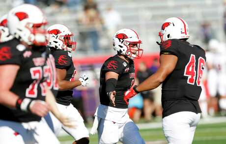 UIW quarterback Jon Copeland is congratulated by teammates after he scored a touchdown against NW State on Saturday, October 26, 2019 at University of Incarnate Word.