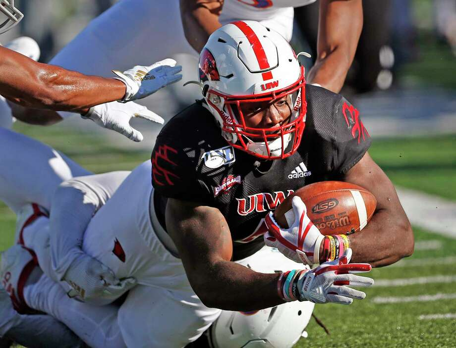 UIW running back Kevin Brown is brought down by NW State defenders on Saturday, October 26, 2019 at University of Incarnate Word. Photo: Ronald Cortes/Contributor / 2019 Ronald Cortes