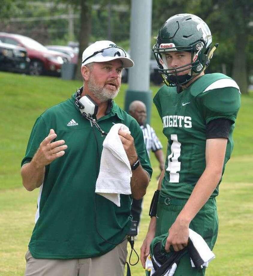 MELHS coach Bob Keplar, left, talks to his son, MELHS quarterback Zach Keplar, during a regular-season game in Edwardsville. Photo: Scott Marion|The Intelligencer