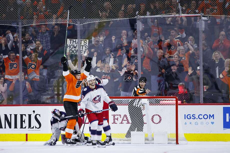 The Flyers' James van Riemsdyk reacts to his game-tying goal against Blue Jackets goaltender Joonas Korpisalo (left), with Oliver Bjorkstrand skating away midway through the third period. of an NHL hockey game, Saturday, Oct. 26, 2019, in Philadelphia. The Flyers won 7-4. (AP Photo/Chris Szagola) Photo: Chris Szagola / Associated Press