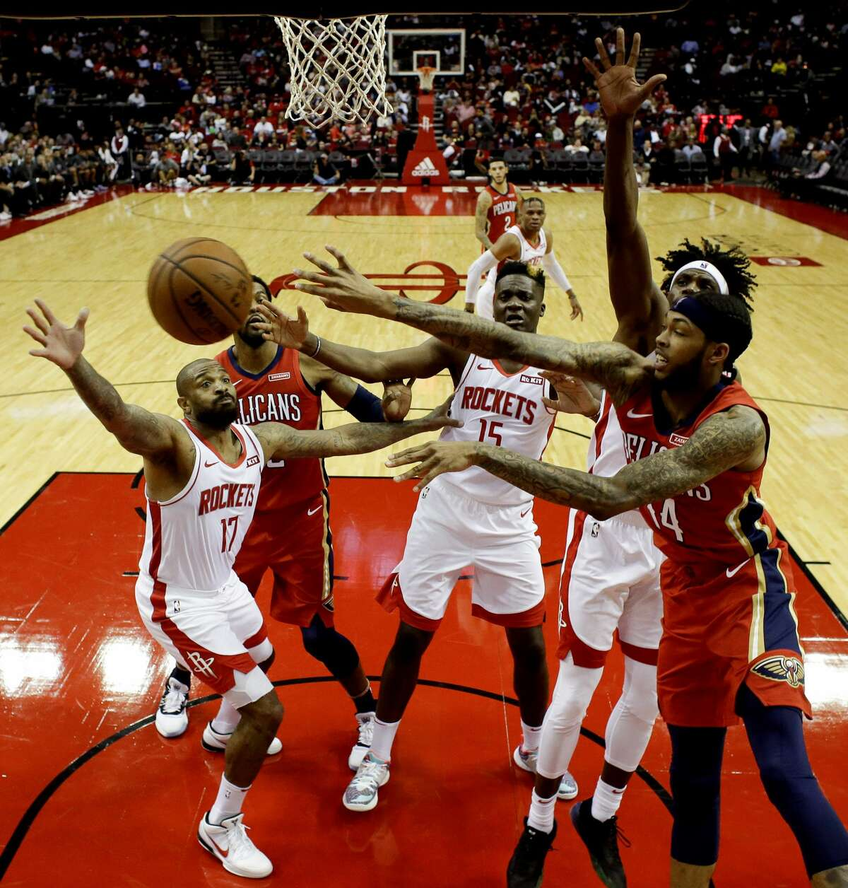 New Orleans Pelicans forward Brandon Ingram, right, passes the ball during the second half of an NBA basketball game against the Houston Rockets, Saturday, Oct. 26, 2019, in Houston. (AP Photo/Eric Christian Smith)